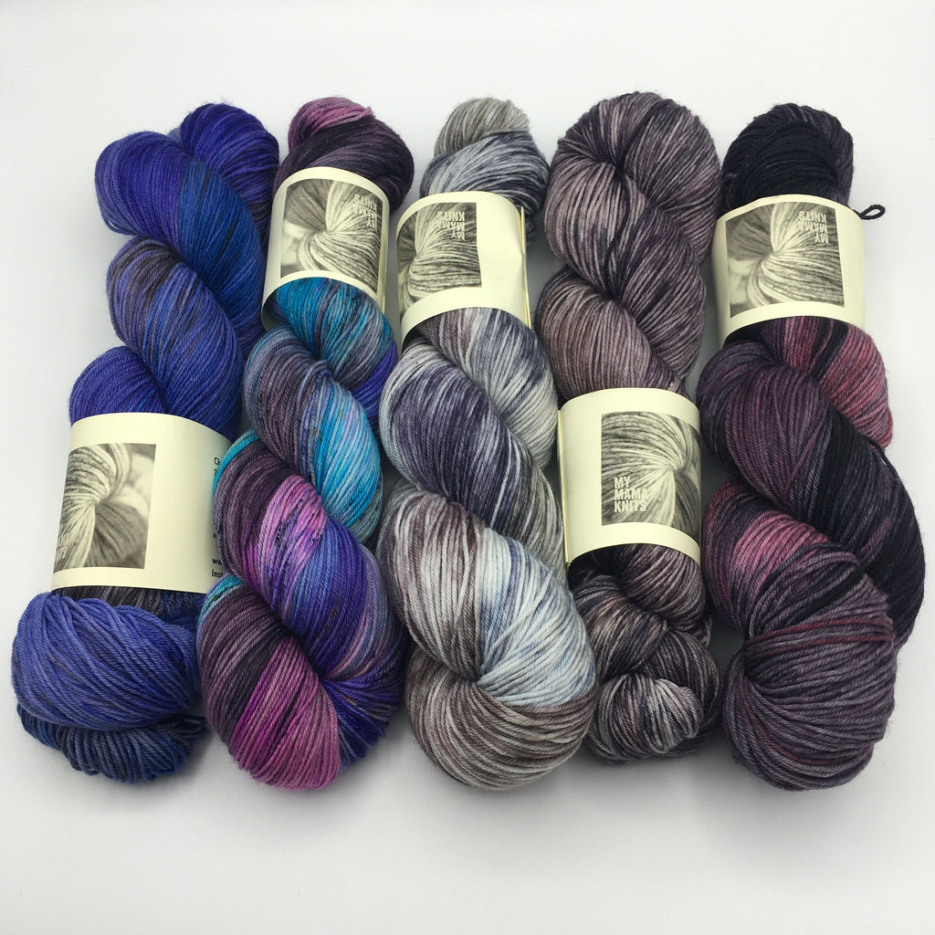 5 hanks of hand dyed yarn in shades of purple