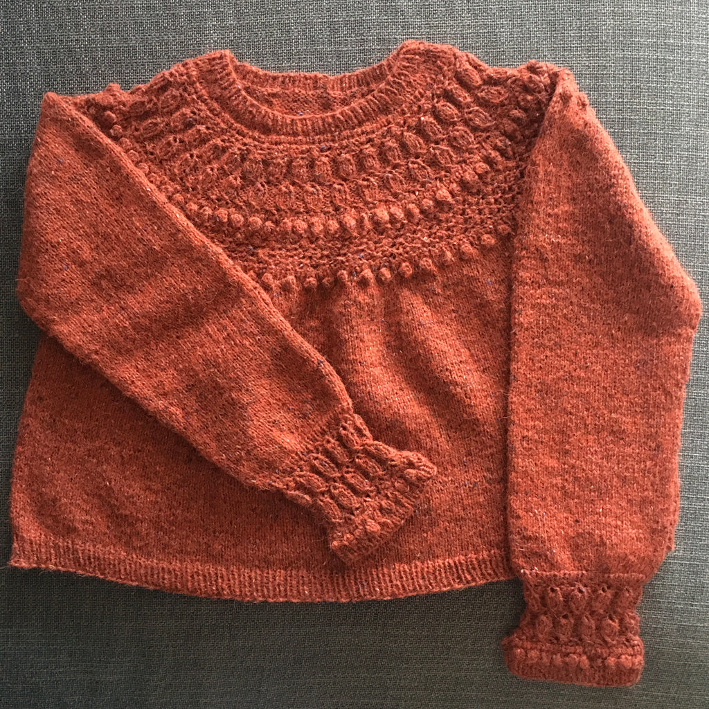 orange handknitted jumper at the woolly brew