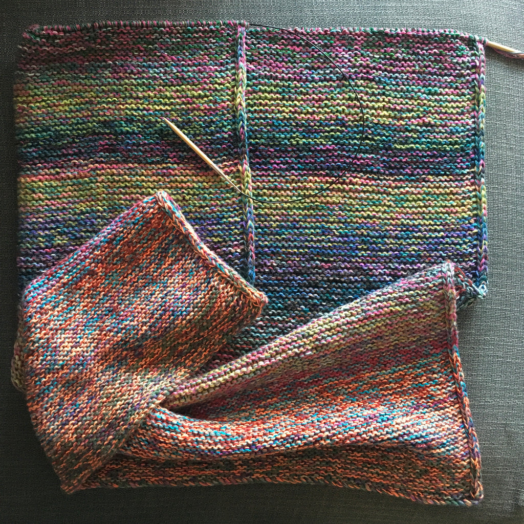 unfinished knitted blanket in multi coloured yarn