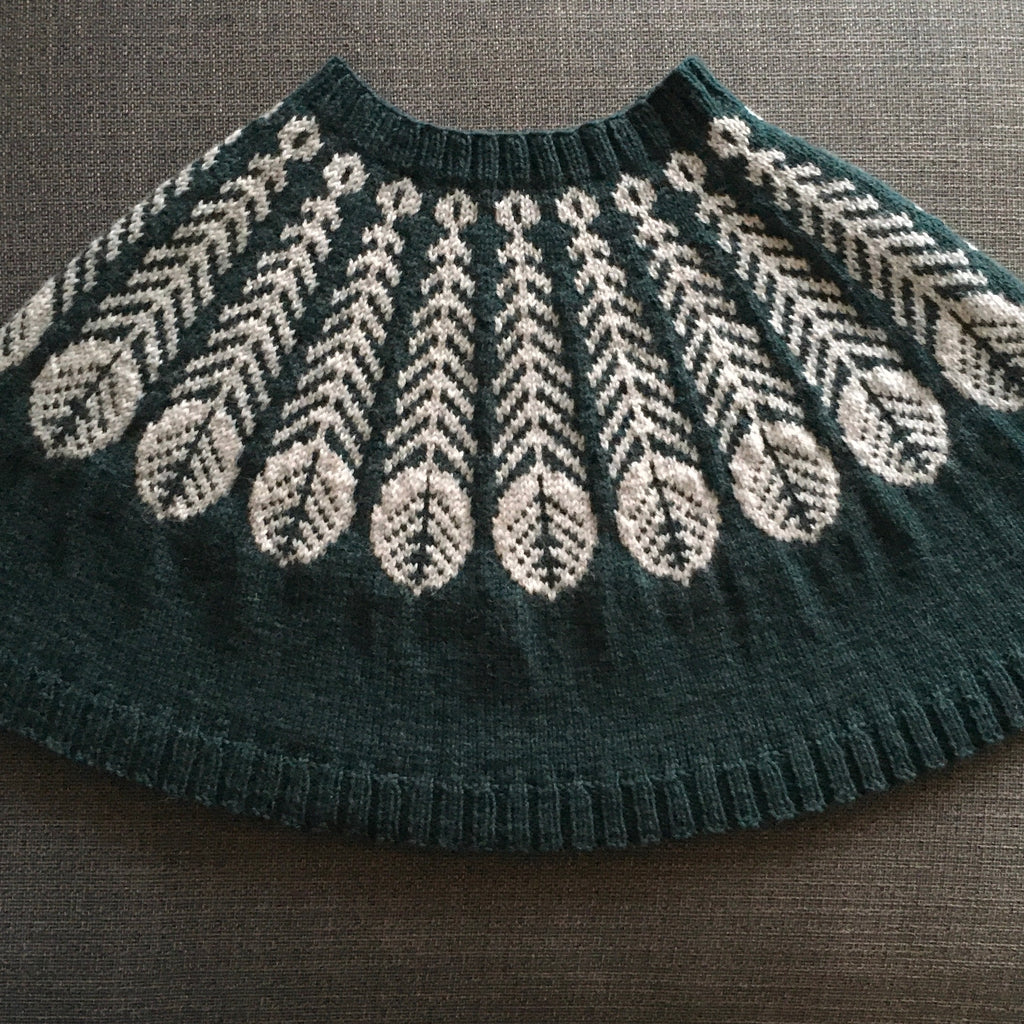 handknitted poncho with feather colourwork design at yoke