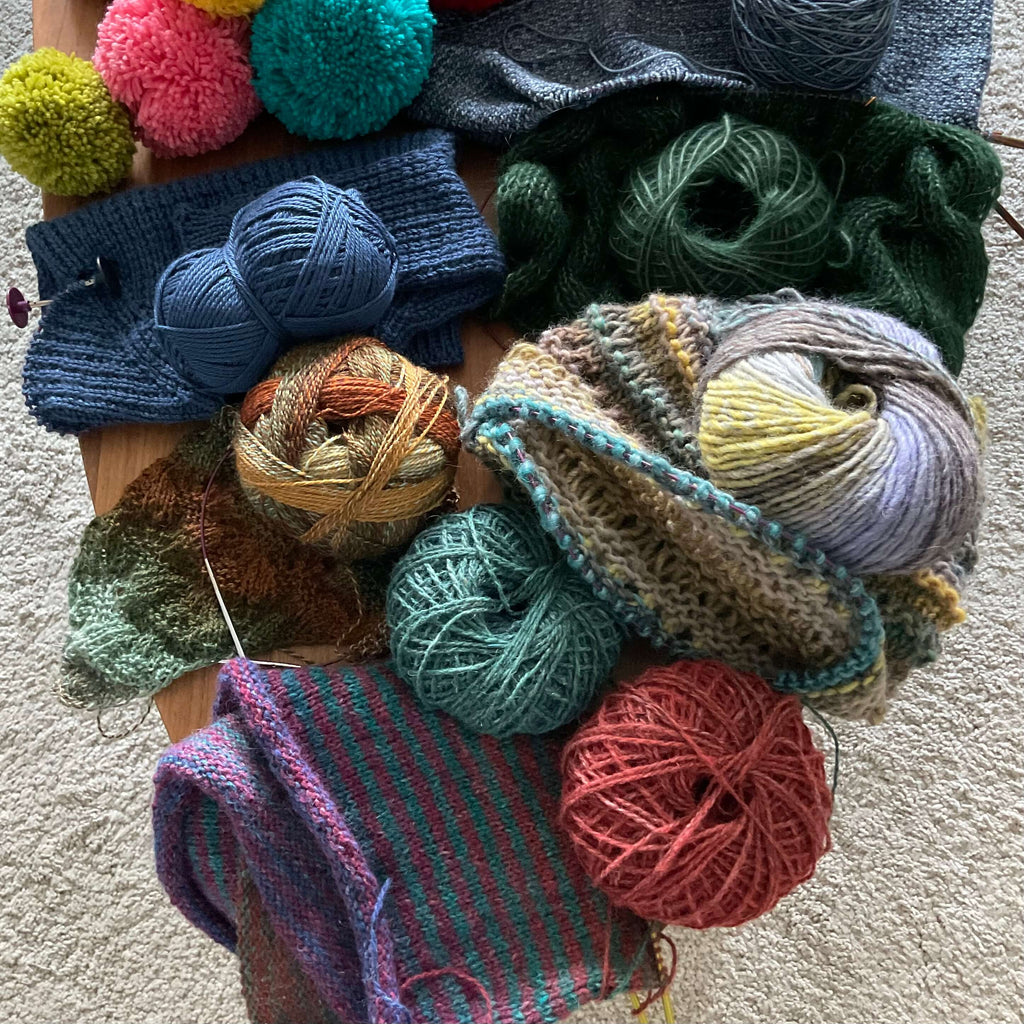 table full of knitting projects