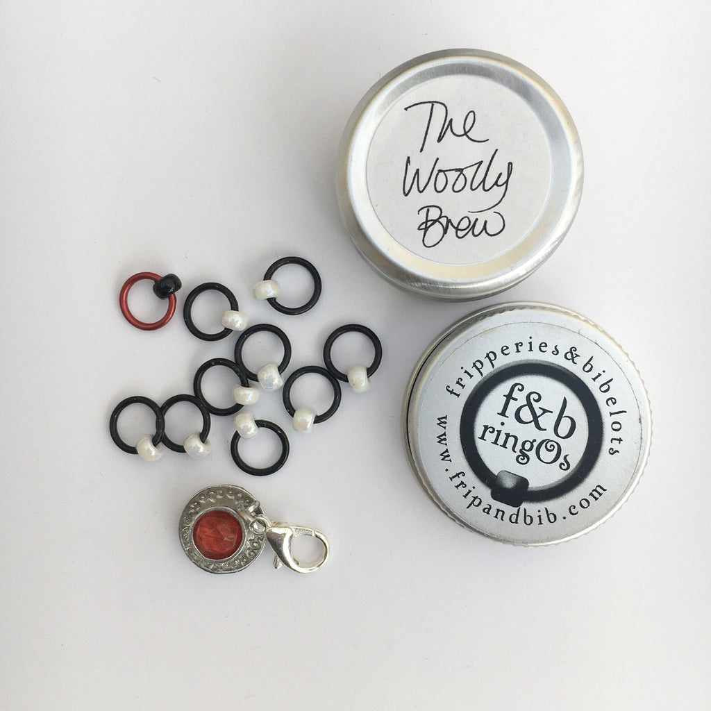 tin of stitch markers by fripperies and bibelots