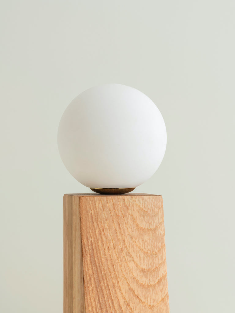 Tradam - 1 light oak and opal ball table lamp