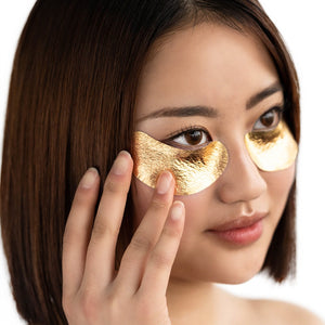 Model wearing the VIP The Gold Mask Eye under her eyes