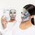 Image of a model wearing the PRO Platinum Peel Mask Pack and holding the box of the PRO Platinum Peel Mask Pack