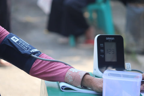 person taking their blood pressure