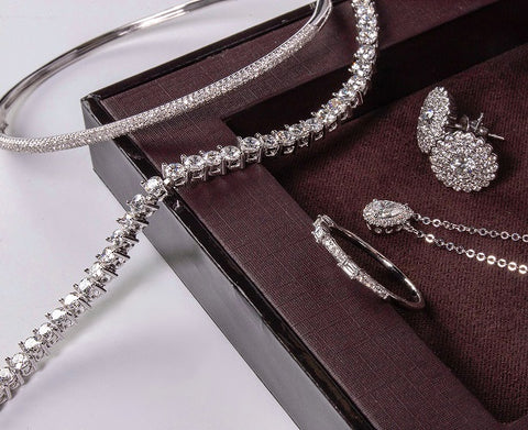 collection of jewelry in white gold and diamonds