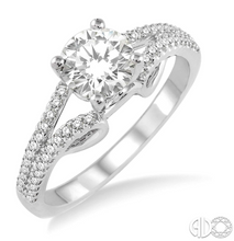 Load image into Gallery viewer, Express your eternal love to your love with this resplendent diamond Engagement Ring. Styled in Glinting 14 Karat White Gold, this ring is embellished with 48 sparkling round diamonds, prong set, accenting diamonds that flow down the split shank in brilliant rows. The ring showcases a .47 Carat round SI-1 I Diamond.  The Total Diamond Weight of the ring is .80 Carat