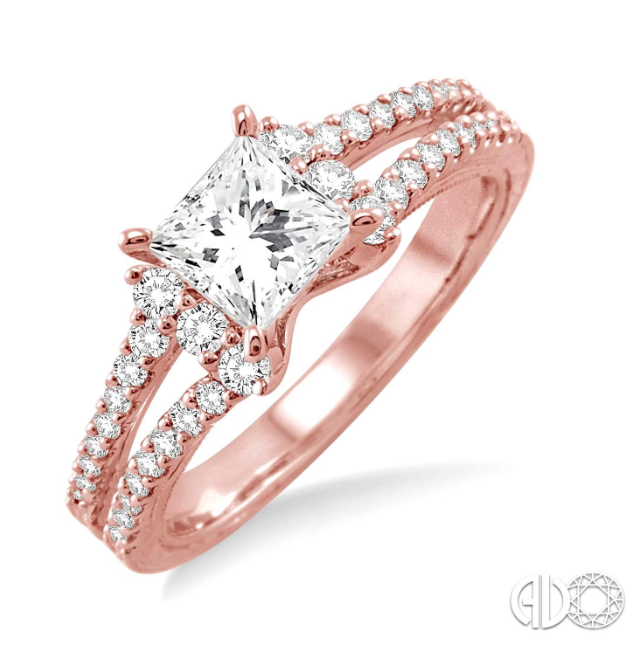 1/3 carat total weight semi mount engagement ring in 14 Karat Rose/Pink Gold. The ring showcases 38 round cut diamonds elegantly prong and pave set. this ring is designed to frame your choice of center stone ranging from .85 carat to 1.20 carat. The center stone is not included in the price and is sold separately. The finger size is 6.5. The total diamond weight of the ring is 1/3 carat total weight.