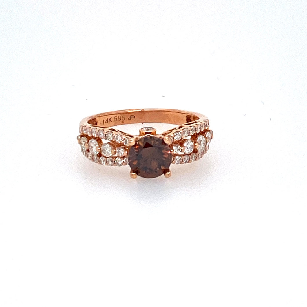 This gorgeous 1.07 Carat Round Cognac Diamond is set into this 14 Karat Rose Gold 3.2 Gram Semi Mount. The semi Mount Features Three rows of Round Diamonds totaling .83dtw .   Finger Size 6.25