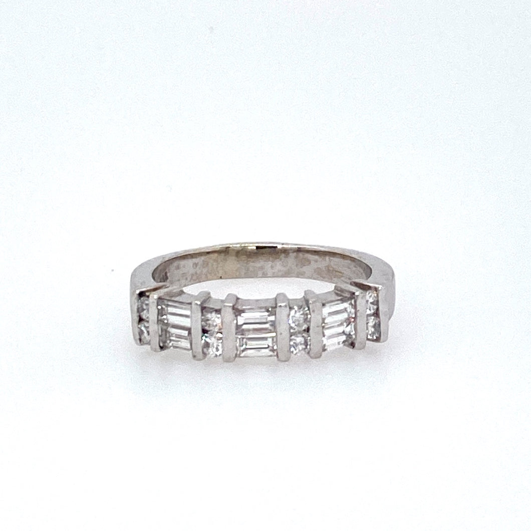 This 14 Karat White Gold Band Features 1.00dtw of Round and Baguette VS Diamonds  Total Weight is 6.4 Grams  Finger Size 8