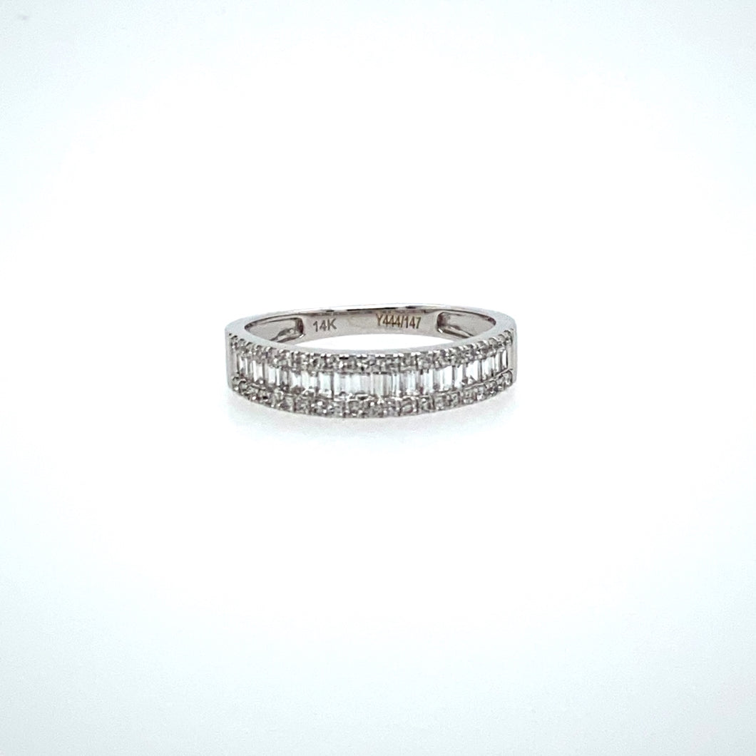 This 14 Karat White Gold Band Features Baguette-Cut Diamonds Down the Center and Round Diamonds on the Outside Edges.  Finger Size 6.5  Width of Band 4.3mm  Total Diamond Weight .67 Carat  Total Weight 2.5 Grams