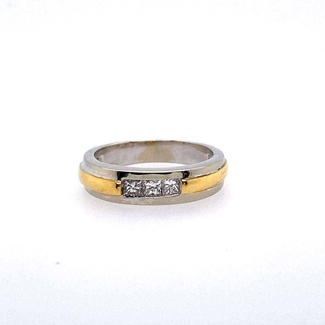 This Estate Men's Platinum and 18 Karat Yellow Gold Band Features Three (3) Round Diamonds, Channeled In a Row in the Center.  Approximate Total Diamond Weight .25 Carat  Finger Size 7  Total Weight 6.0 Grams