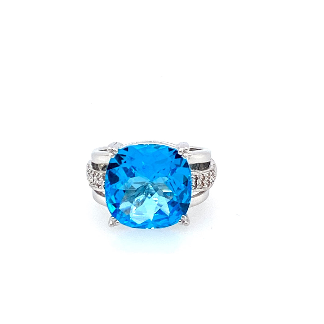 Beautiful Blue! Rock this ring in a Pair of jeans or dress it up, this 14 Karat White gold Faceted Blue Topaz ring with accent Diamonds will surely be noticed  Finger Size 7