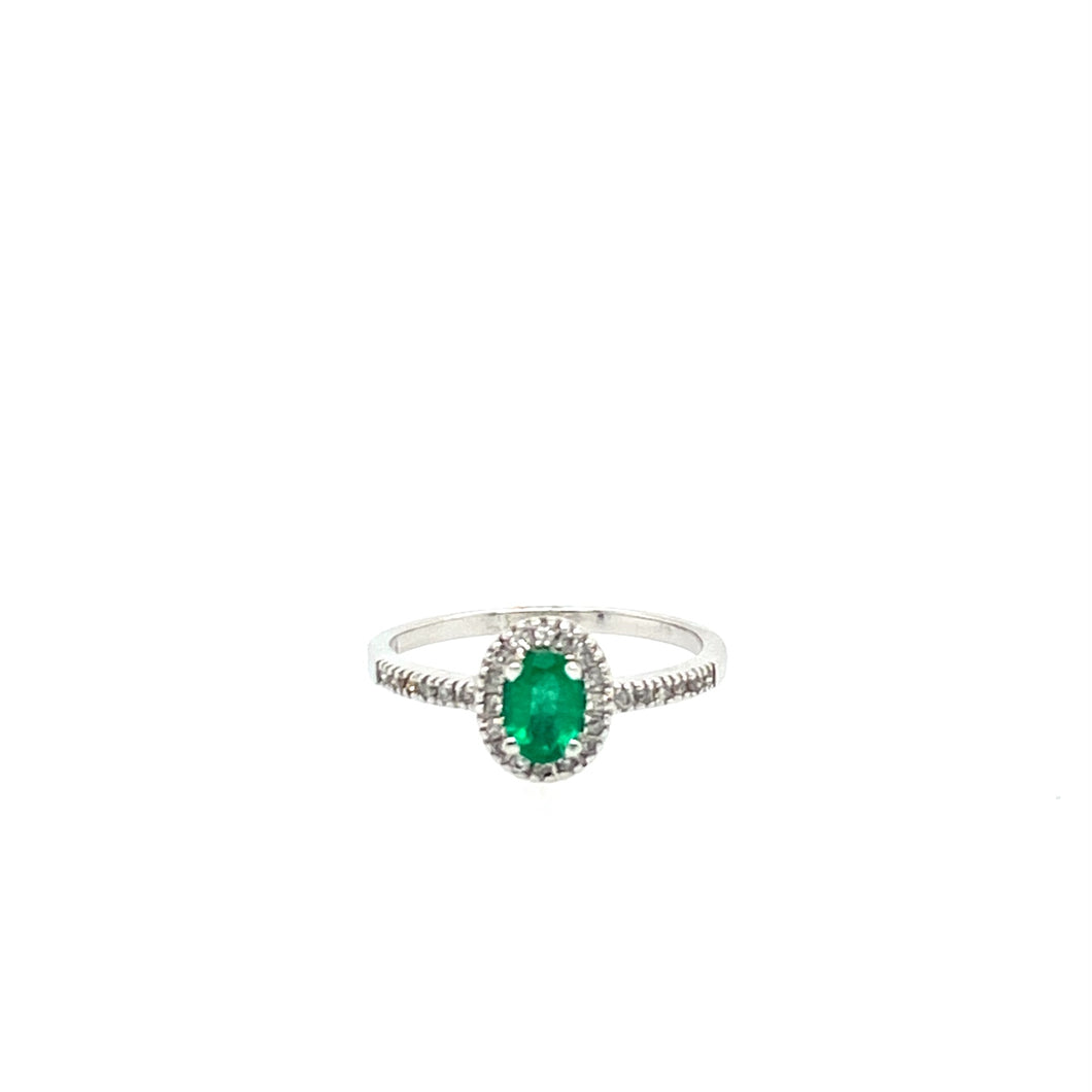 This Dainty 14 Karat White Gold Ring Features a .41 Carat Emerald Gemstone surrounded by a Diamond Halo  Total  Diamond Weight is .14dtw  Finger Size 7