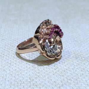 Have some fun with this 14 Karat Rose Gold Estate Ring, featuring 6 Ruby Gemstones and 2 Diamonds, set in a Swirl Design.  The Total Weight of the Ring is 9.0 Grams.  Finger size is 5.75