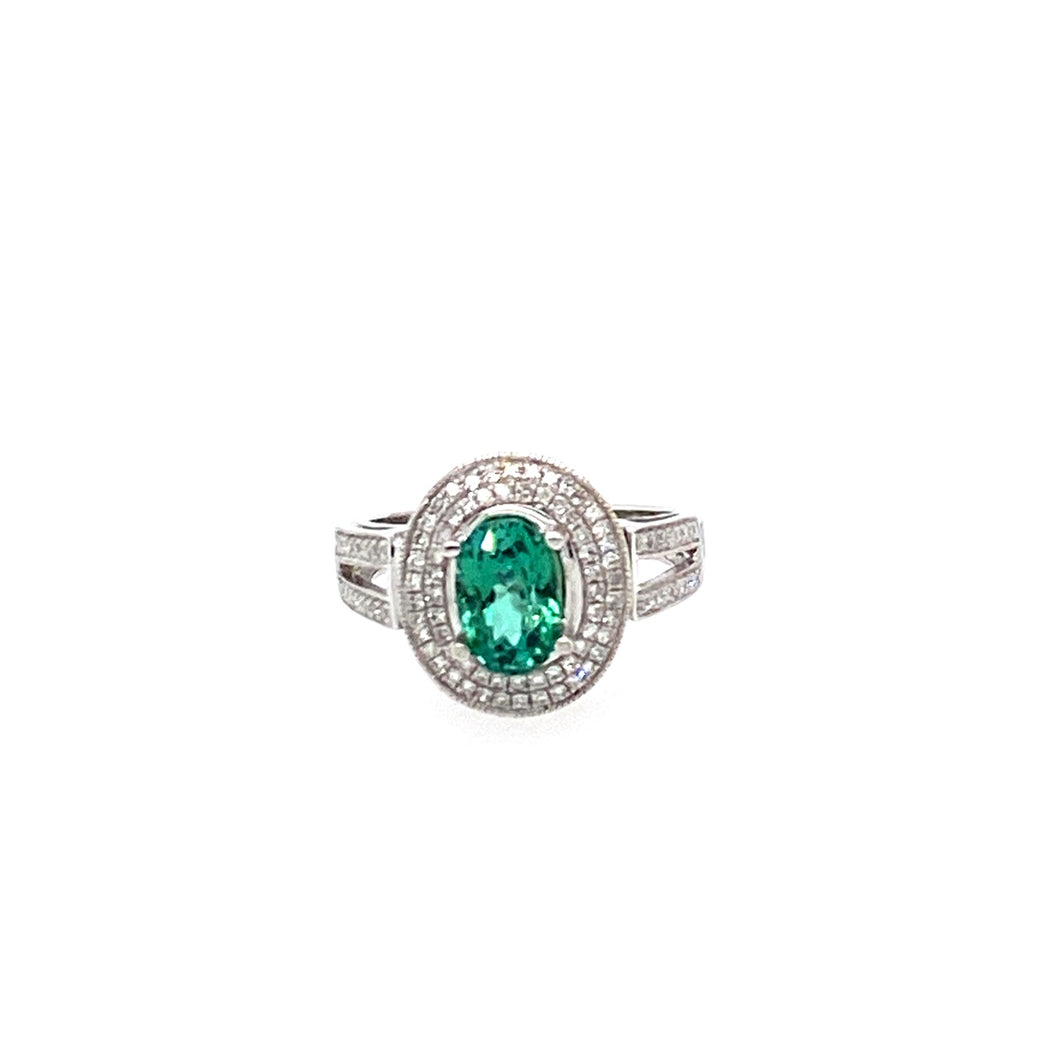 The 14 Karat White Gold Open Shank Design with a Double Diamond Halo Embellishes the Beauty of this Oval 1.4 Carat Green Tourmaline Ring.  108 Total Diamonds  Finger Size 5