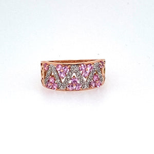 This 14 Karat Rose Gold Band Features a Zig Zag of White Diamonds with Round Pink Sapphire Gemstones in Between.  Finger Size 7