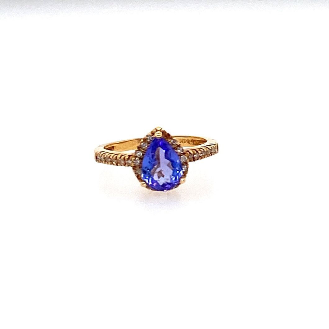 This 14 Karat Yellow Gold Estate Ring Features a 1.12 Carat Pear Shape Tanzanite Gemstone with 28 Diamonds to Form a Halo Design.  Total Weight 2.5 Grams  Finger Size 5  Estate Ring - All Weights are Approximate
