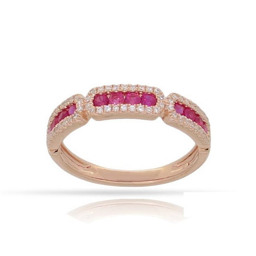 14 karat rose gold .46ctw ruby .20ctw diamond band with a finger size of 6.5