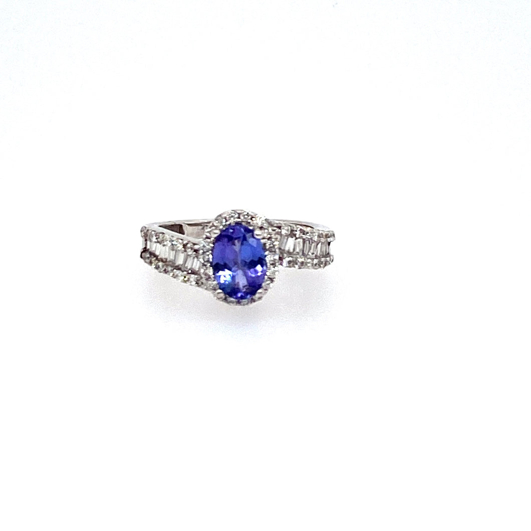 62 Round and Baguette Cut Diamonds Showcases this Beautiful Blueish-Purple Oval Tanzanite Gemstone, all set into 18 Karat White Gold.   Finger Size 4.75  Total Weight 3.5 Grams  Estate ring - all Weights are Approximate