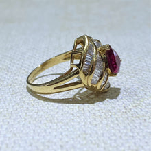 Load image into Gallery viewer, The Perfect Ballerina style ring for that special night out, this 18 Karat Yellow Gold Estate Ring features a Pear Shaped Ruby gemstone (approximately 1.50ct) surrounded with approximately 1.00ctw of Baguette Diamonds channel set around the gemstone. The Total weight of the ring is 5.0 Grams.  Finger size is 6.25