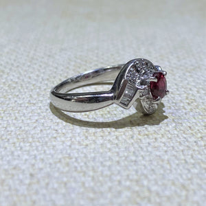 This Gorgeous Platinum Ruby and Diamond Estate Ring features a .45 carat Ruby gemstone, prong set in the center, with .15ctw of Baguette and Round Accent Diamonds. The total weight of the ring is 7.7 Grams  Finger size is 6  Weights are Approximate