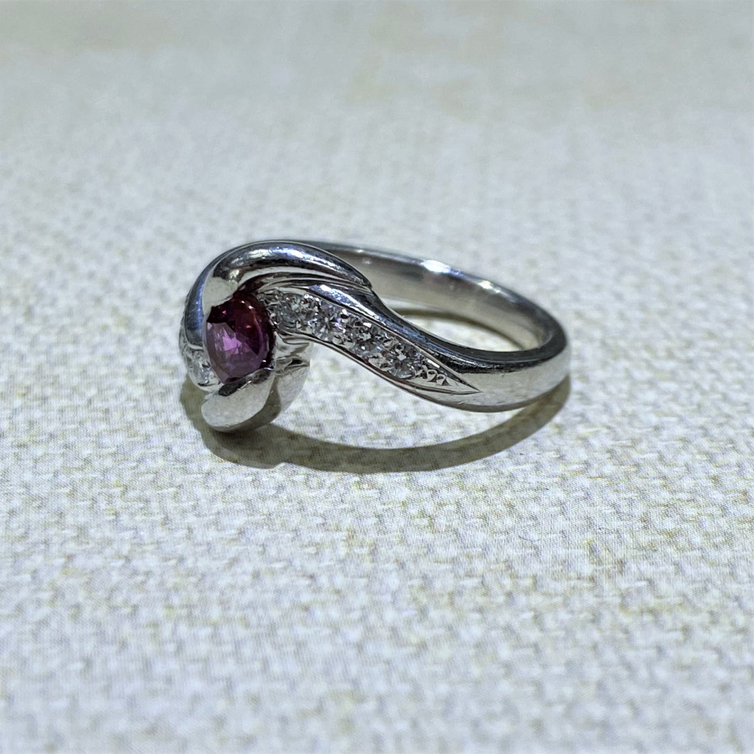 Beautifully set in Platinum, this estate ring features a .64 Carat Ruby gemstone with .15dtw of diamonds to accent the stone. Total Weight of the ring is 7.6 Grams.  Finger size is 6