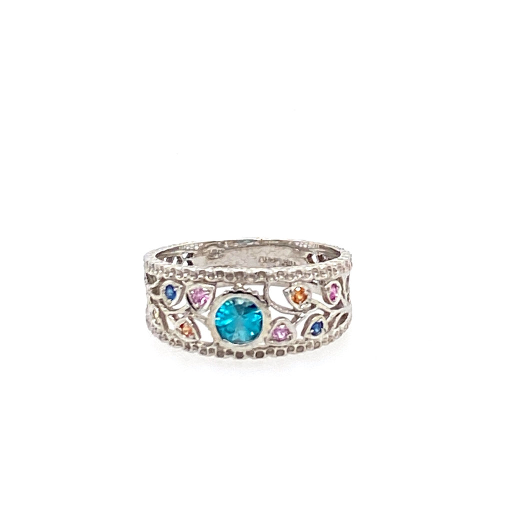 One of our favorites, this 10 Karat White Gold Band Features a Bezel set Tourmaline with Multi Colored Sapphire Gemstones on each side creating a