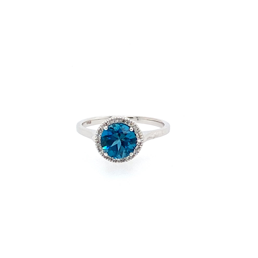 Simply Beautiful best describes this 10 Karat White Gold ring Featuring a Round London Blue Topaz Gemstone with a Diamond Halo around it.  Finger Size 6.75