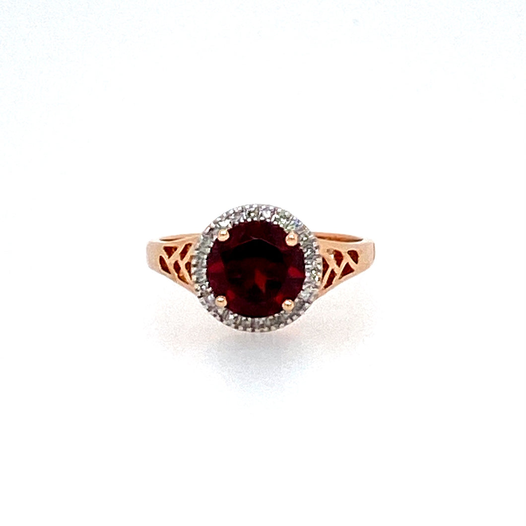 This 10 Karat Rose Gold Ring Pairs Beautifully with this 2 Carat Garnet surrounded in a Diamond Halo.  Total diamond Weight .11ctw  Finger size 7