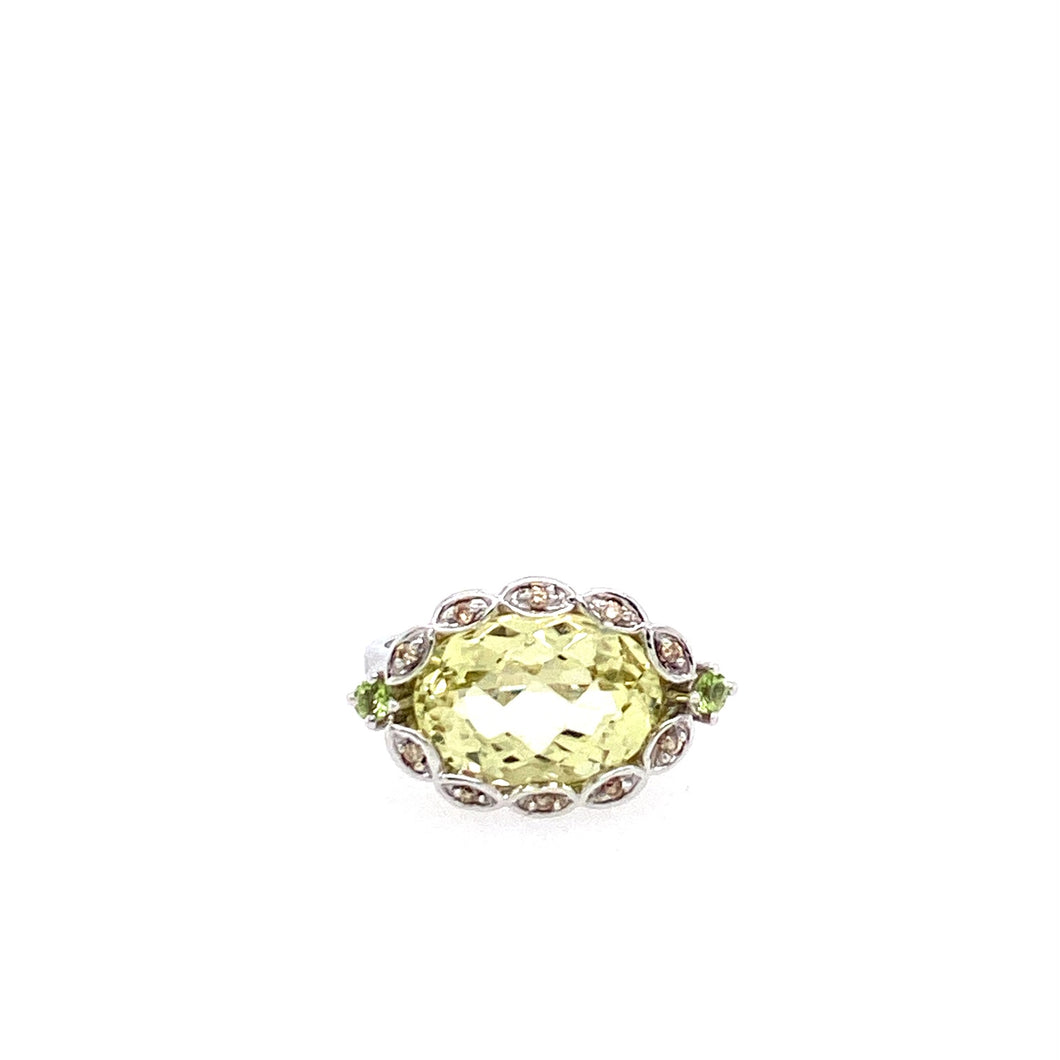 This 14 Karat White Gold Ring features a Green Quartz with a twisted Diamond Bezel Halo.  Finger Size 7