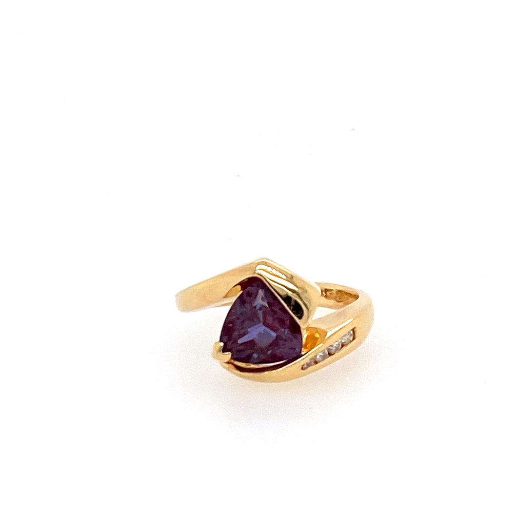 This Trillion Cut Created Alexandrite stone is set in 14 Karat Yellow Gold with 4 Diamonds set on one side for an added sparkle.  Total Weight is 5.4 Grams  Finger Size 6.25