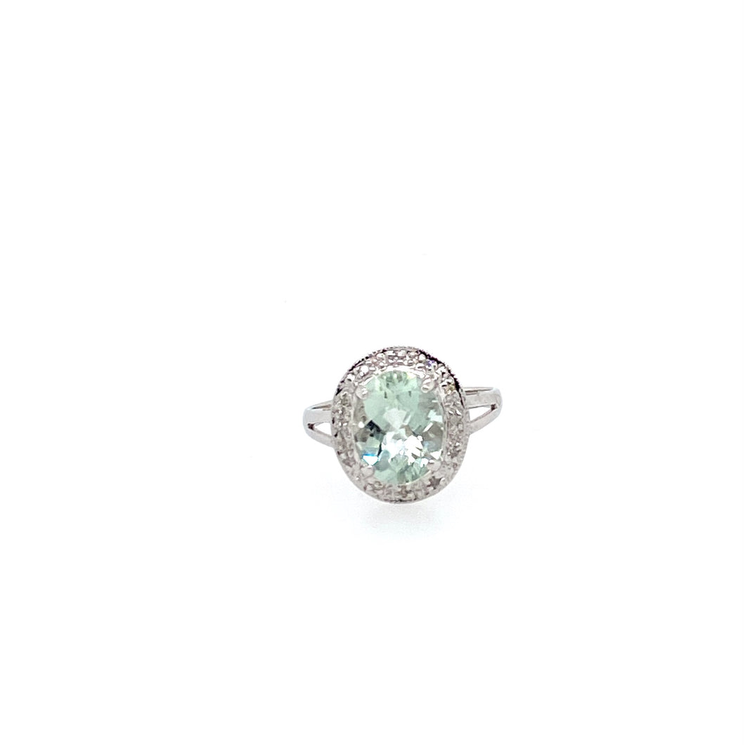 This Oval Shaped Green Amethyst Ring will pair with any spring or summer outfit. The Stone is showcased by a Diamond Halo.  Finger size 6.5  Total Diamond Weight .10dtw