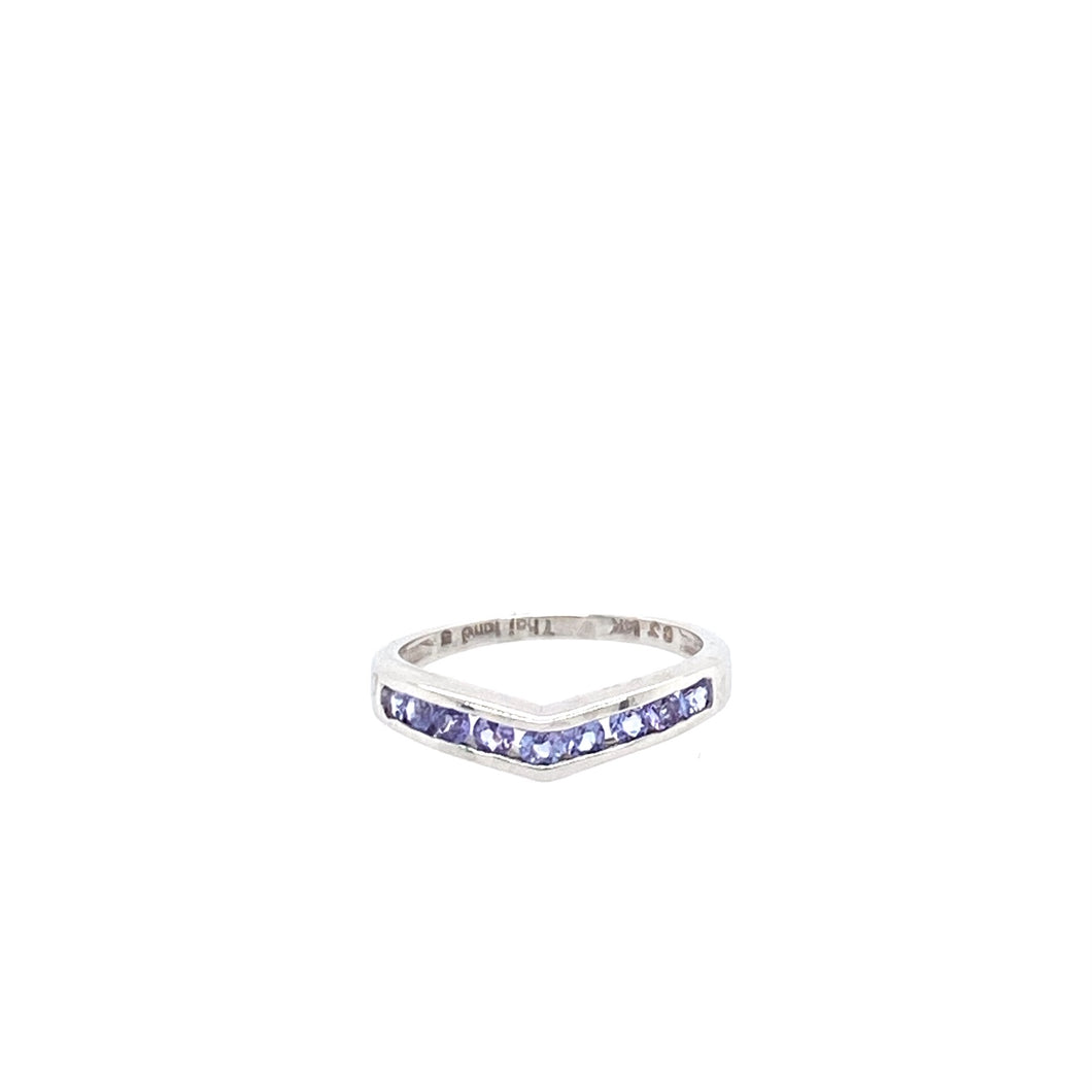 14 Karat White Gold Band Features 9 light colored Tanzanite gemstones in a