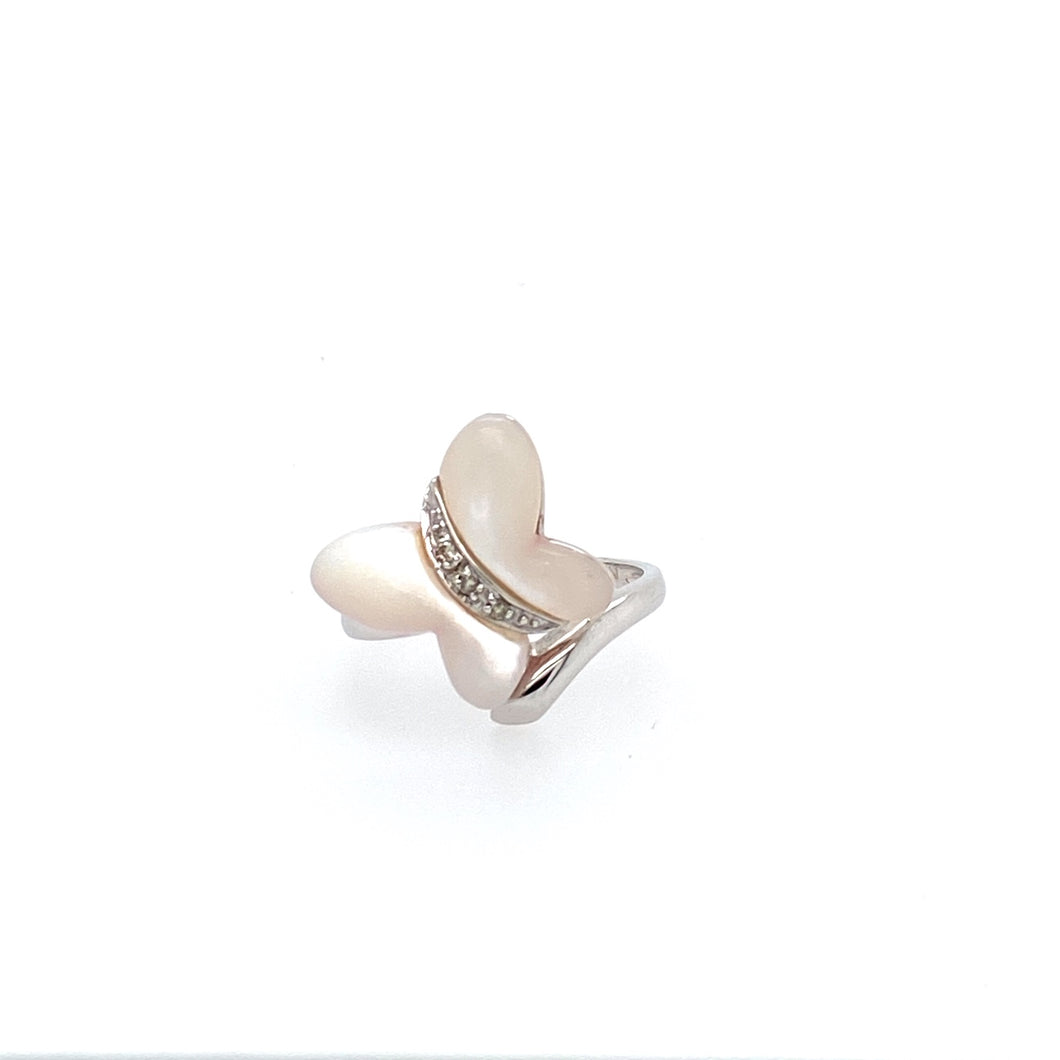 This Cute 14 Karat White Gold Dainty Butterfly Ring Features Mother of Pearl Shaped in a Butterfly with Accent Diamonds down the Center  Finger Size 6.5  Total Weight 3.4 Grams