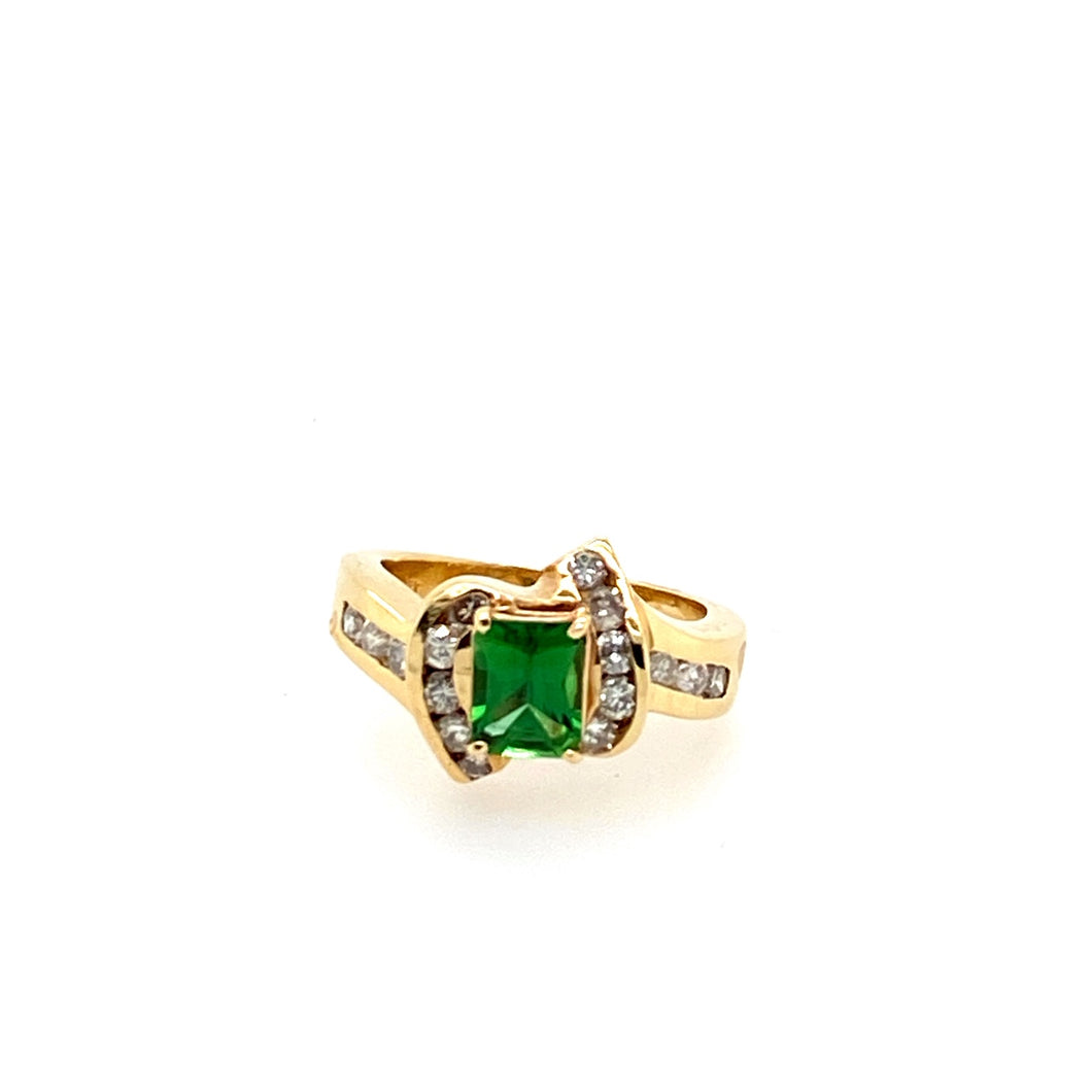 14 Karat Yellow Gold Estate Green Garnet Ring. The Green Garnet is Accented with .50 Carats of Channel set Round Diamonds.  Finger Size is 6.5  Weights are approximate