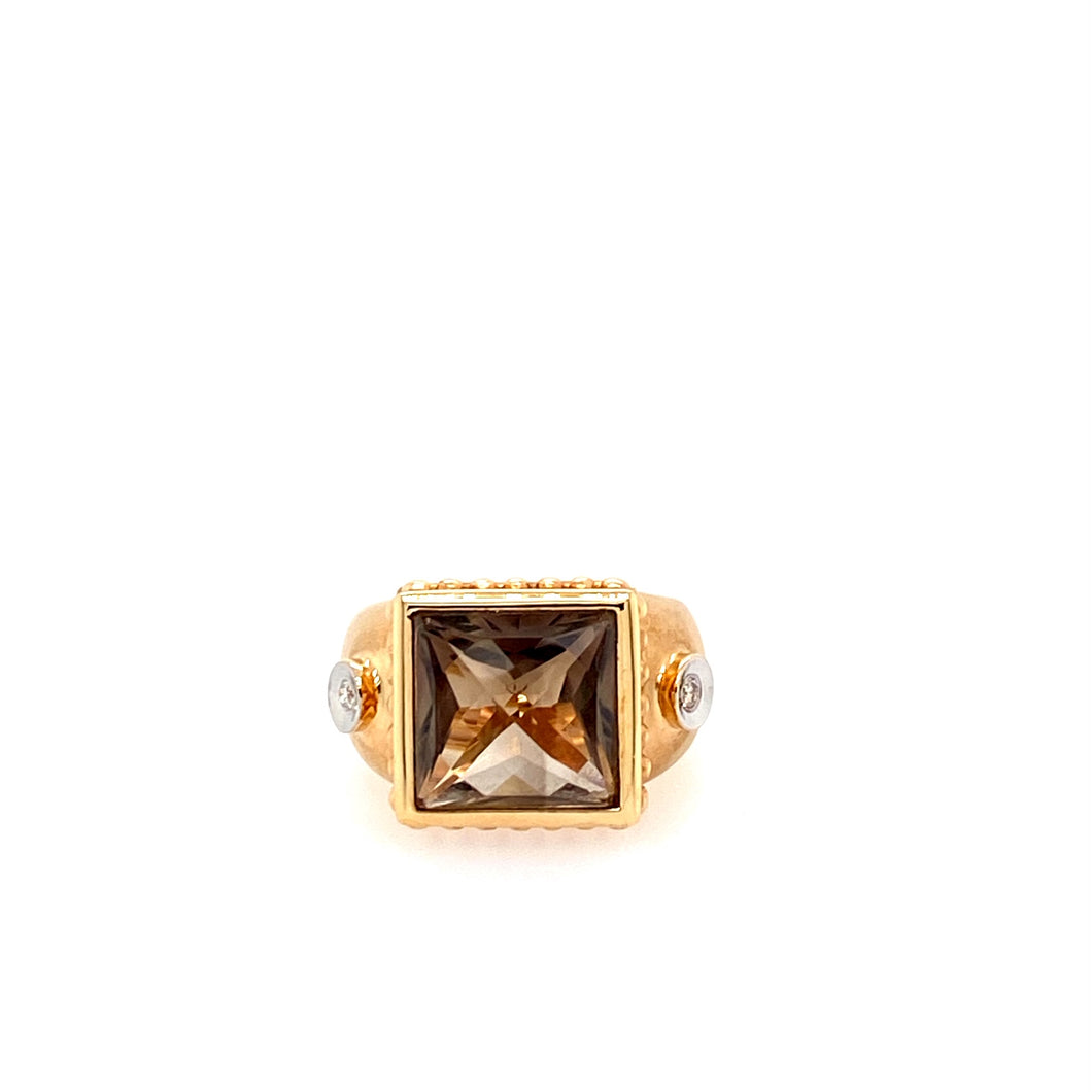 This Square Shaped Smokey Quartz is bezeled into the 14 Karat Yellow Gold (brushed finish)Ring showcased with a bezel set diamond on each side.   Total Weight is 7.7 Grams  Finger Size 6