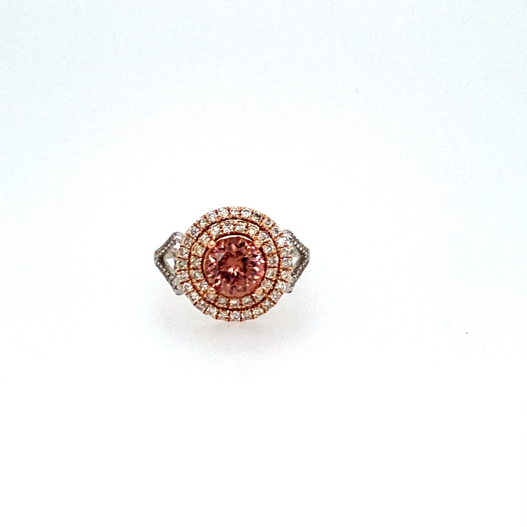 It will make You think Deeply and Find the Correct answer, Pink Zircon is a Gemstone that increases the owners analysis Power.  This Gorgeous 1.94 Carat Round Salmon Pink Colored Zircon is Surrounded in a Double Yellow Gold Halo featuring 101 Diamonds in the Split White Gold Shank.   Finger Size 6