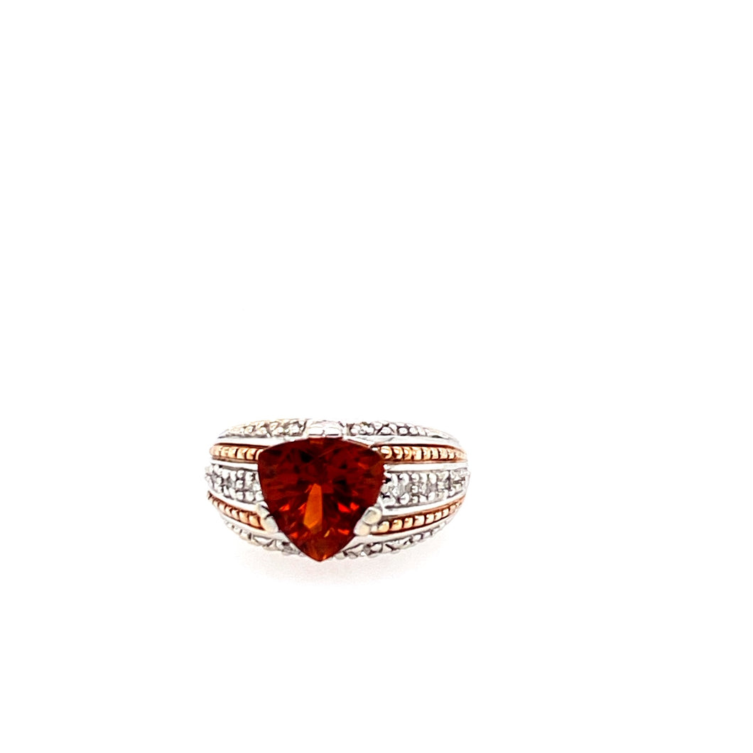 Beautifully Designed, this 14 Karat White Gold Ring Features a Triilion Cut Spessartite Gemstone, some Accent Diamonds, and 2 Rows of Yellow Gold Rope Design.  Total Weight is 7.7 Grams  Finger Size 7