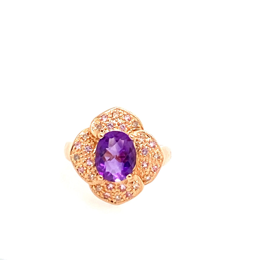 One of our favorites, this 1.04 Carat Amethyst Ring has .17dtw of White Diamonds, Pave set, into a pretty 14 Karat Rose Gold Flower Shaped Design   Finger Size 7