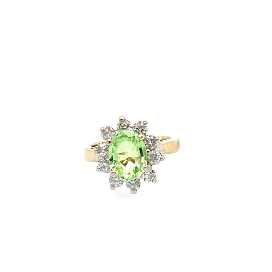 14 Karat White Gold 1.5 Carat Oval Green Tourmaline Ring with a yellow Gold shank, with .65ctw of Diamonds set around it.  Finger Size 4.75  Total Weight 5.1 Grams  Weights are approximate