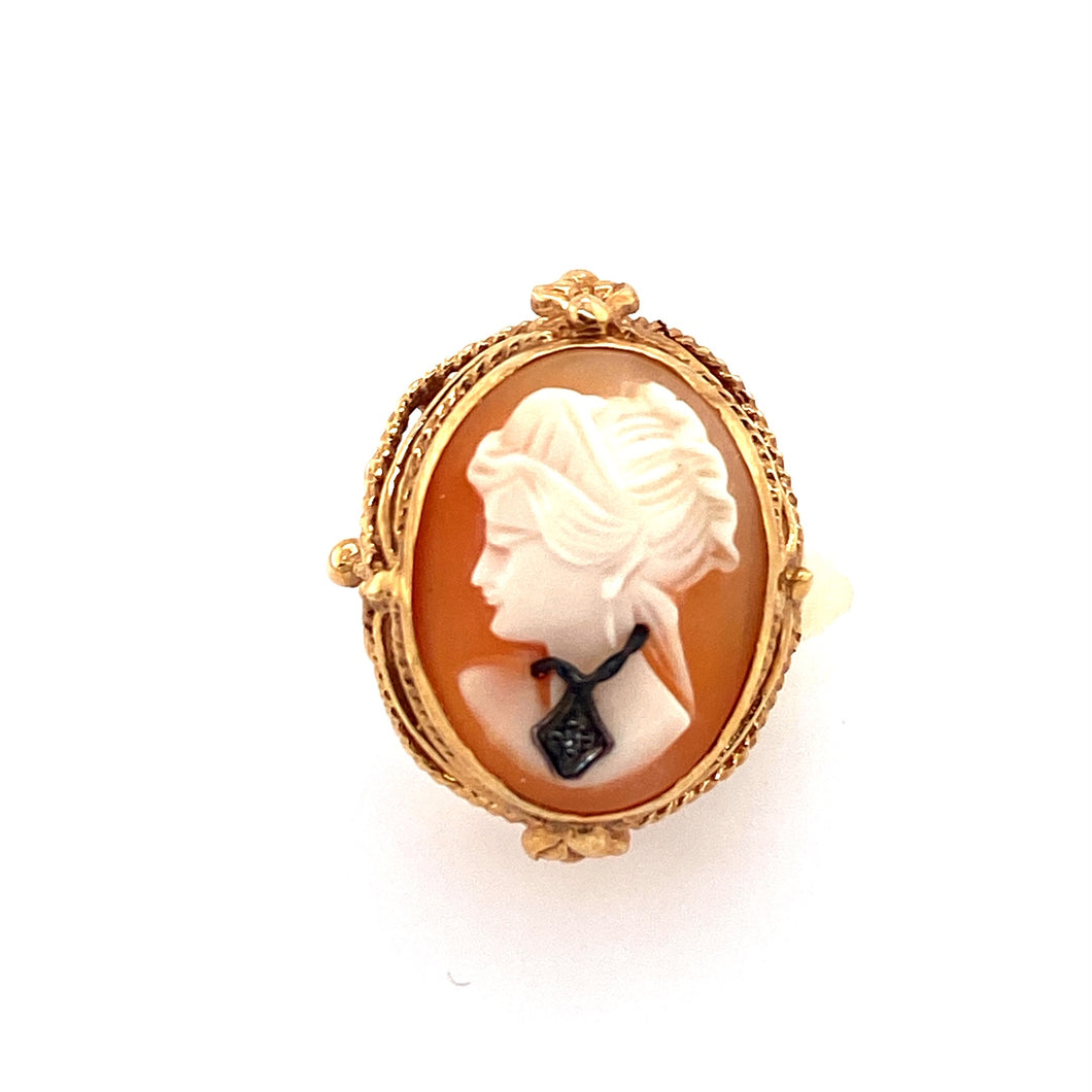 So much Pretty Detail in the 14 Karat Ring Mounting Holding this Beautiful Cameo of a Lady, Featuring a Dark Necklace with a Tiny Diamond in the Center. Measures Approximately 18.0mm x 25.0mm  Finger Size 5.5  Total Weight 7.1 Grams