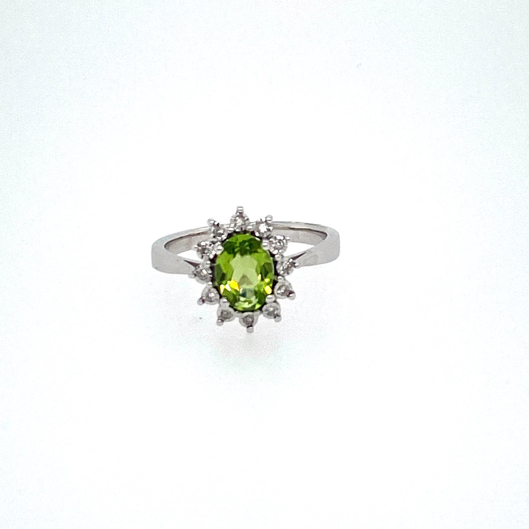 Set into this Crown Like Halo is a Pretty Green Peridot Gemstone.  .09dtw  Finger Size 7 Metal is 14 Karat White Gold