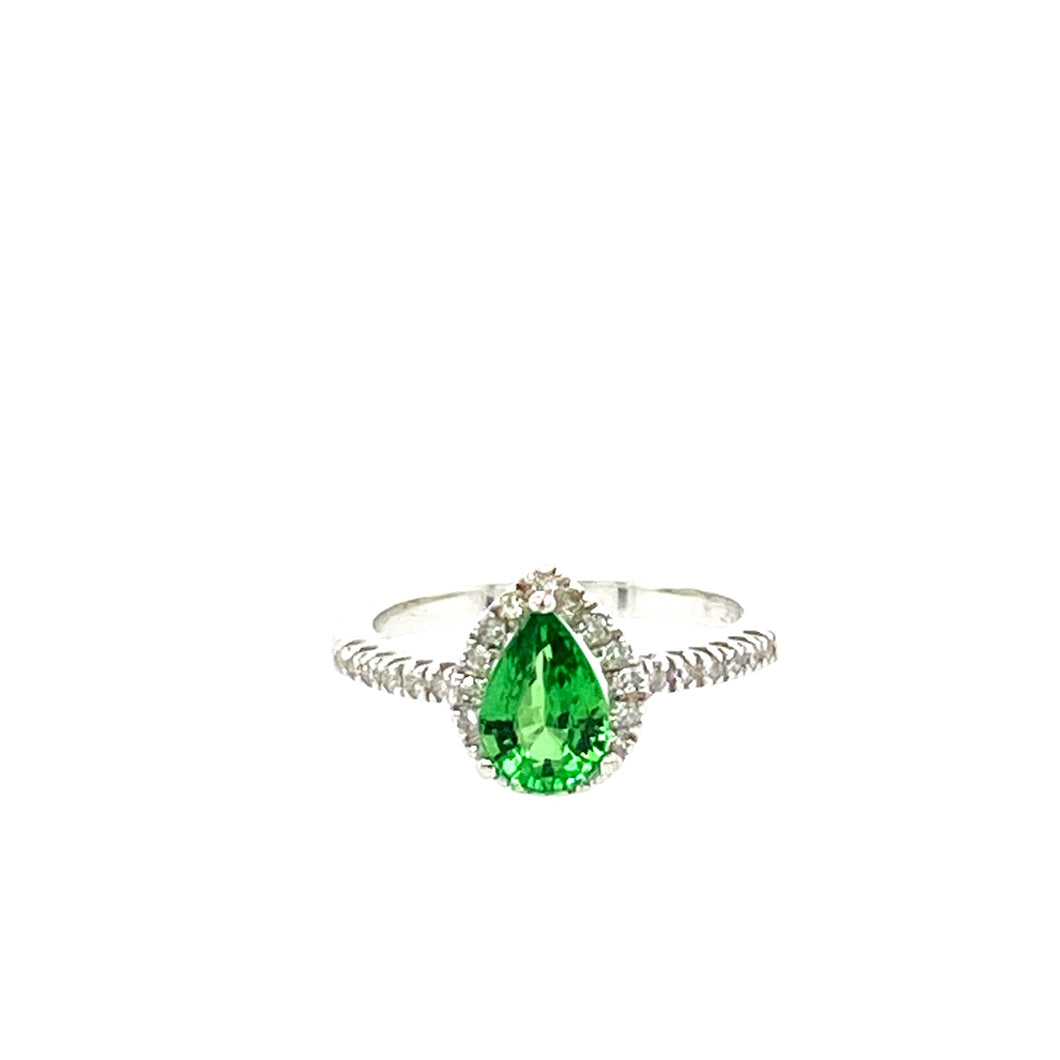 Discovered in Kenya and Tanzania, this pretty Pear Shaped Tsavorite Gemstone Ring is set in a Diamond Halo Design in 10 Karat White Gold.  Finger Size 5