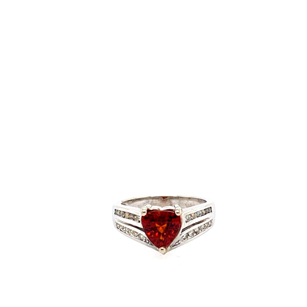You will love the vibrant color of this Spessartite Trillion Cut Gemstone.  The 14 Karat White Gold Ring setting features Two rows of Channel set Diamonds.  Total Weight is 5.5 Grams  Finger Size is 6.75