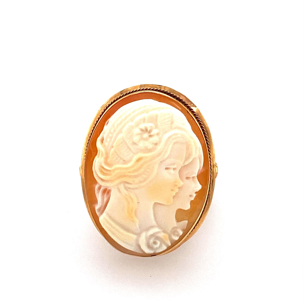 This Beautiful Estate 14 Karat Yellow Gold Ring Features a Cameo of Two Ladies, Encased into a Smooth Top Oval Mounting. The Ring Measures Approximately 26.0mm x 21.0mm. A Rope Design around the Side of the Oval Mounting Completes the Ring. Finger Size 5.75  Total Weight 4.8 Grams