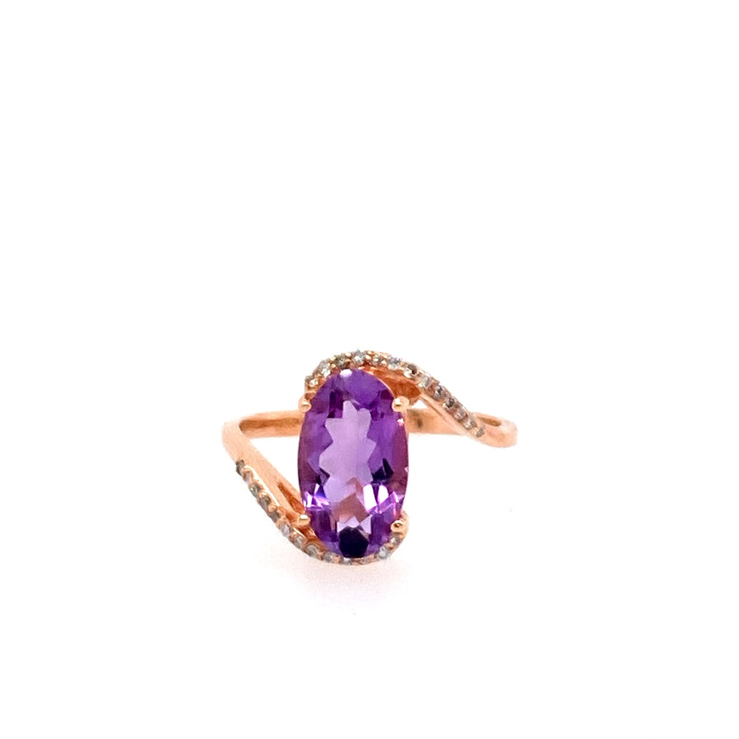 Long and Slender, this gorgeous Oval Purple amethyst is Embellished with .12dtw of White Diamonds set in 14 Karat Rose Gold  Finger Size 7