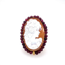 Load image into Gallery viewer, This Gorgeous Estate Ring Features 14 Karat Yellow Gold with an Oval Cameo of a Lady. Set All the Way Around the Cameo is Garnet Gemstone Beads. Finger Size 5  Measures Approximately 40.0mm x 27.0mm  Total Weight 8.4 Grams