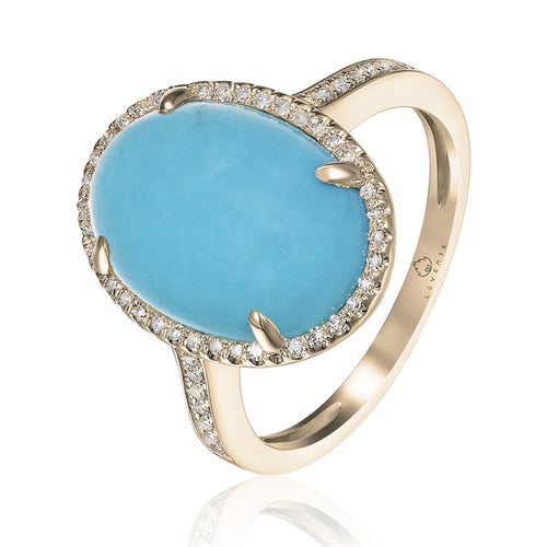 A Favorite Combo. Turquoise and Yellow Gold.  This 14 Karat Ring Features a 5.92 Carat Oval Turquoise with just the right amount of Diamonds  to accent this Beauty